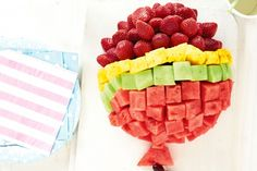 Fruit Balloon: party food with fresh fruit presented in a gorgeous balloon shape.