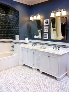 High contrast navy bathroom. Pretty, even though I hope to never have another tile in my home. From: http://www.bowerpowerblog.com/2012/12/picky-picker/