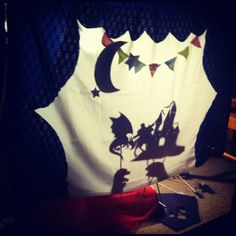 Shadow puppet theater - love the bunting and moon.