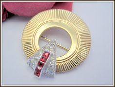 Offered by VintagObsessions, this unsigned Marcel Boucher brooch is in the art deco style. Set in go