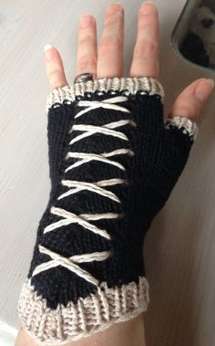 Free Knitting Pattern for Corset Fingerless Mitts - Penelope Privett's handwarmers are inspired by corset design and easy to make. Pictured project by CiaraNiamh