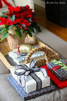 Wrapped books decorate this living room ottoman for the holidays