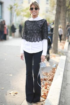 Helena Bordon's Best Street Style Outfits - a black boatneck lace crop top styled over a crisp white button-down, and paired with black flare leg pants