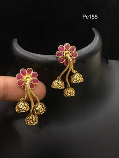 Beautiful triple jumki hanging earing. Ear ring with flower design. Ear ring studded with pink color stones. 14 September 2017.
