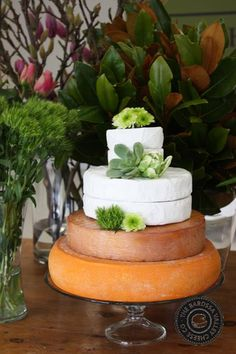A beautiful cheese wedding cake by Barossa Cheese Company!  Barossa Valley Cheese Company, Angaston, Barossa Valley  Cheese wedding cake. Tower of beautiful cheese for celebration or wedding. Decorated with flowers or fruit this is becoming a very popular choice for all the beautiful bride and grooms out there!