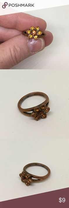 🆕Vintage Copper Ring with Amber Rhinestones A size 5.5 copper ring with lovely Amber rhinestones in the shape of a flower. Some wear noted, but otherwise in very good condition. The ring you could wear with your Fall fashions! Vintage Jewelry Rings