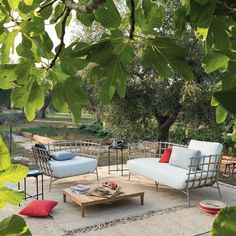 Discover the quality of Unopiù's Armchair Tweed stainless steel and teak - Create your design outdoor space now