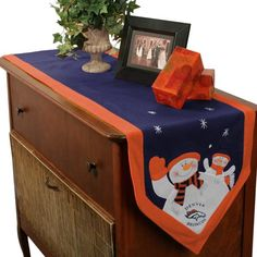 Denver Broncos Snowman Table Runner. Add your Broncos spirit to your holiday celebration with this padded polyester snowman table runner!. Price: $29.95