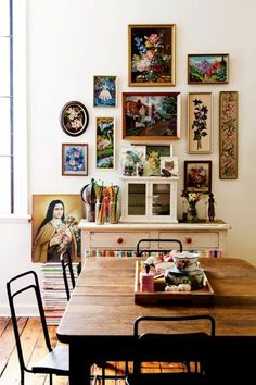 framed needlepoint gallery wall in dining room - picture frame ideas