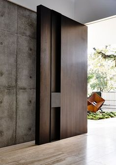 Huge front door on invisible hinges. Cool, sleek and modern