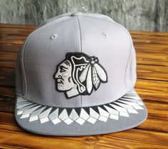 - 100% cotton - Raised embroidered front logo with print on cotton applique - Printed pattern on under visor - Snap closure - Officially licensed x Mitchell & Ness