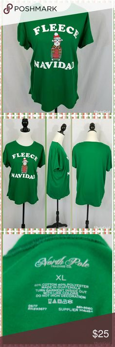 "Novelty Christmas shirt This shirt is too cute. The green t-shirt reads ""Fleece Navidad"". A little play on words to the standard Christmas greeting: Feliz Navidad. Notice the cute little sheep on the front - AKA fleece. Short sleeve, crewneck. 60% cotton /40% polyester. Machine washable. Please feel free to ask questions about fit and style before purchasing. This would be perfect for a Christmas party. North Pole Tops Tees - Short Sleeve"