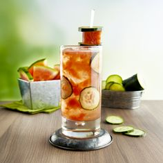 #Summercocktail #recipe! The Melting Pot's Summertime Sipper a is light, fruity and perfect for a hot summer day! Fresh watermelon and cucumber come together with Malibu Rum and fresh lime juice to create a refreshing cocktail you'll want to sip all summer long. #DipIntoSummer