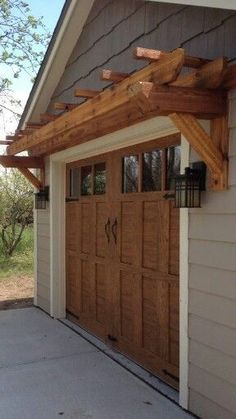 Curb Appeal on a Dime choose from several garage door trim styles: Our economy kit offers a broad casing upon three sides when attached increase jambs while our premium kit features a detailed 8 wide pilaster set and a large mantel header in the manner House Design, Updating House, House Front, House Exterior, Garage Doors, Exterior Design, New Homes, Garage Pergola, Garage Door Trim