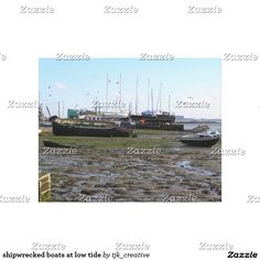 shipwrecked boats at low tide canvas print