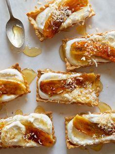 Honey Cream Tarts With Caramelized Banana And Toasted Coconut recipe: Mini Banana, Honey + Coconut Cream Tarts Coconut Recipes, Tart Recipes, Banana Recipes, Sweet Recipes, Dessert Recipes, Cooking Recipes, Coconut Desserts, Dessert Tarts, Dinner Party Recipes