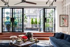 House tour: an industrial loft renovation in New York: Stepping into this New York City loft apartment directly from the building's lift is like entering the box of a camera, its panoramic exposure taking in the New Yorker hotel and Hudson River.