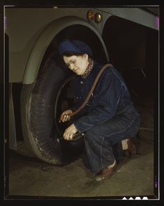 """""""War production workers at the Heil Company making gasoline trailer tanks for the U.S. Army Air Corps., Milwaukee, Wisconsin. Mrs. Angeline Kwint, age 45, an ex-housewife, checking the tire of trailers. Her husband and son are in the US Army. [1943]"""
