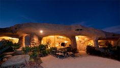 House of the Flintstones - Beautiful single family cave house inspired by the Flintstones animated series is located in Malibu, California. Unusual house is equipped with large windows, cave inspired interior, and wood burning fireplace. Real life Flintstones house is currently for sale for only $3,500,000.