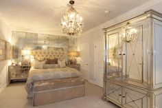 Beautiful bedroom decor! I love the mirrored hutch!