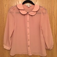 Adorable light pink blouse Adorable sheer light pink blouse with a unique collar Forever 21 Tops Blouses