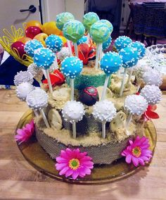 Caki Pops | Great Barrington | Gallery  Beach themed cakepops and display. Client requested something for a 60th birthday for a woman who collects heart rocks. We decided a beach theme with sand dollar sugar cookies hidden in the brown sugar sand with chocolate cake balls with hearts on them hidden with in the wash of the shore.  All gluten free too!