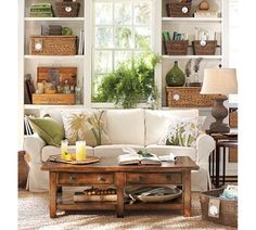 Bookcase styling using wicker baskets. Great idea to hold cd's, dvd's, etc. Pinned from potterybarn.com