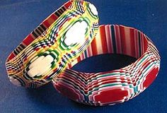 French designer, Lea Stein. Carved and polished Lucite laminate bangles.