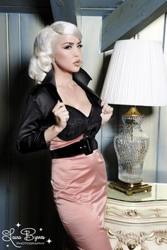 Deadly Dames Bad Girl Bolero with Vamp Collar in Black Satin - The Bad Girl Bolero shrug is back this season in shiny Shakira satin for your more glamourous looks.  With three-quarter sleeves and the signature Deadly Dames stand up Vamp collar, the bolero will fit a wide range of bust sizes - check the size chart for arm measurements!