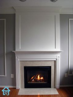 """Base cap installed under the crown to give an 'upgraded crown' look. Base cap continues around the perimeter of the room, which does not have crown, yet. Basecap & wall up to ceiling painted with trim paint. Remodelando la Casa: Adding Visual Interest and Height to your Fireplace. Overmantel is comprised completely of MDF, with 1/2"""" trim finishing off the inside edges of the MDF on the center panel."""