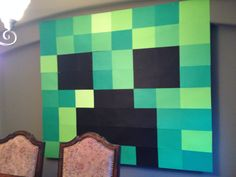 Giant Minecraft creeper Banner. I bought a package of multi shades of green card stock and black card stock from Michaels and taped them together to form this perfect creeper backdrop