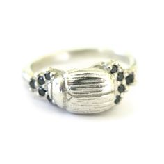 Silver Ring Pave Set with 10 Gemstones    Beetle - 12 x 8mm, with gemstones =19mm width. Band width - approx 2,5mm  Weight - 5.8 grams    Please see our info page for more details on sizing  ** for quotation on Gold with Diamonds please email - anna@annarosholt.com