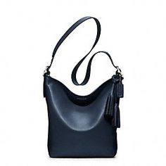 LEGACY LEATHER DUFFLE in Navy @ Coach.com, I luv that coach has focus back on its leather bag.  Classic and Chic!