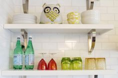 Open shelves are a great way to show off favorite glassware and accessories and also to break up the bulk and monotony of large cabinets.