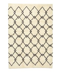 Large, patterned rug with warp and pile in a cotton blend with wool content. Shedding is normal for wool products, but diminishes over time.