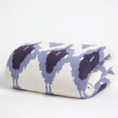 love this ikat throw, and all it's brothers and sisters (houndstooth, chevron, suzani, damask)