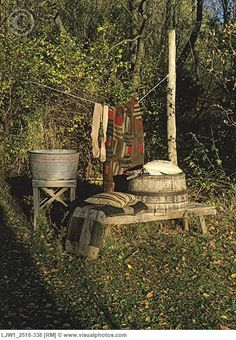 Antique wash tubs...and note the primitive washbench!! Made complete with a line full of clothes!  Love the look...but I'll keep my washer and dryer ;)