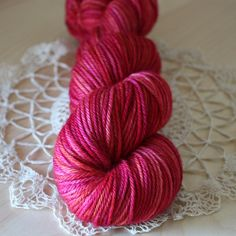 """Pomegranate,"" with vivid (and I mean VIVID) reds, fuchsias, bright roses, and swathes of tangerine throughout.  Only two skeins exist in the entire world - unrepeatable colorway!  Hand dyed by phydeaux designs.  :)"