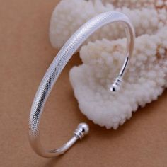 Modern beauty abounds on this sterling silver cuff bracelet. BRACELET DETAILS Length: in. Sterling Silver Cuff Bracelet, Silver Bangle Bracelets, Jewelry Bracelets, Charm Necklaces, Sterling Jewelry, Diamond Bracelets, Necklace Chain, Fashion Bracelets, Fashion Jewelry