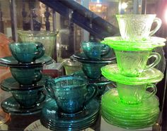 Robinson Antiques at Alfies Antique Market has various coloured Depression glass including these green teacups and saucers.  www.alfiesantiques.com