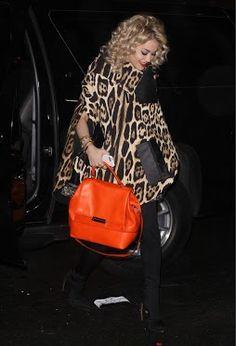 rita ora in leopard with a DVF orange 440 bag