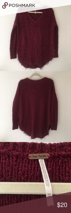 Free People distressed red wine sweater 🍷 Gorgeous and flattering loose fit sweater with very distressed details. Warm and comfy. Excellent condition. From a smoke and pet free home. Red wine coloring. 🍷xs but free People oversized stuff could realistically fit up to a large, just depends how you prefer to wear it. Free People Sweaters V-Necks