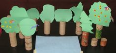 Made trees like this for my preschool esl VBS class to talk about Adam and Eve, I like the idea of making a forest to play with toy animals, though, too.