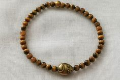 Unique handmade tigers eye mouse bracelet is made using gemstones on strong beading elastic so can be worn by different sized wrists. Vintage Costume Jewelry, Vintage Costumes, Vintage Jewelry, Handmade Jewellery, Handmade Bracelets, Beaded Bracelets, Strong Knots, Tigers Eye Gemstone, Bones And Muscles