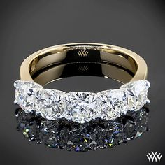 This dazzling Custom 5 Stone U-Prong Diamond Wedding Ring is set in 18k Yellow Gold with Palladium heads that hold 5 brilliant Round Diamonds. The elegant design on the prongs make this truly unique.