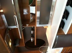 Nice, automatic cabinet opening/closing with push of a button... (CKC Showroom, Cozy in the Kitchen Event March 22, 2012)