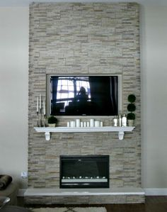 If you decide to rock the fireplace you could break the solidness with a mantel and then a mirror or have your TV set flush with the stone. Tv Above Fireplace, Fireplace Tv Wall, Build A Fireplace, Slate Fireplace, Wall Mount Electric Fireplace, Farmhouse Fireplace, Fireplace Remodel, Fireplace Design, Fireplace Makeovers