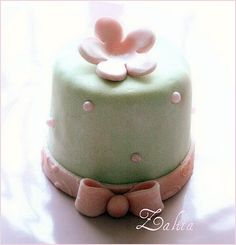 vanilla cake filled with butter cream and covered with marshmallow fondant