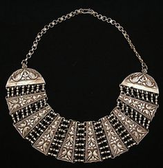 India ~ Rajasthan | Sterling silver necklace has finely embossed images of 44 peacocks and is itself shaped to resemble a fanned peacock tail.  | ca. the late 19th century | The necklace is made of 92.5 percent pure silver | 980$