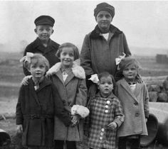 Willi Graf and his sisters, with family. 1926.
